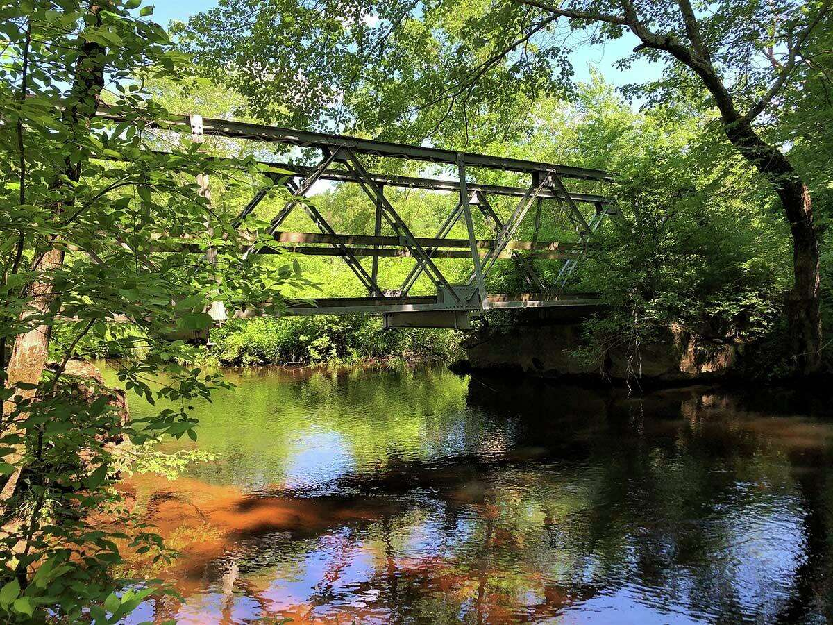 One of two Truss bridges relocated from a crossing over the Mount Hope River by the Mansfield Department of Public Works in 1999 to the Nipmuck Trail.