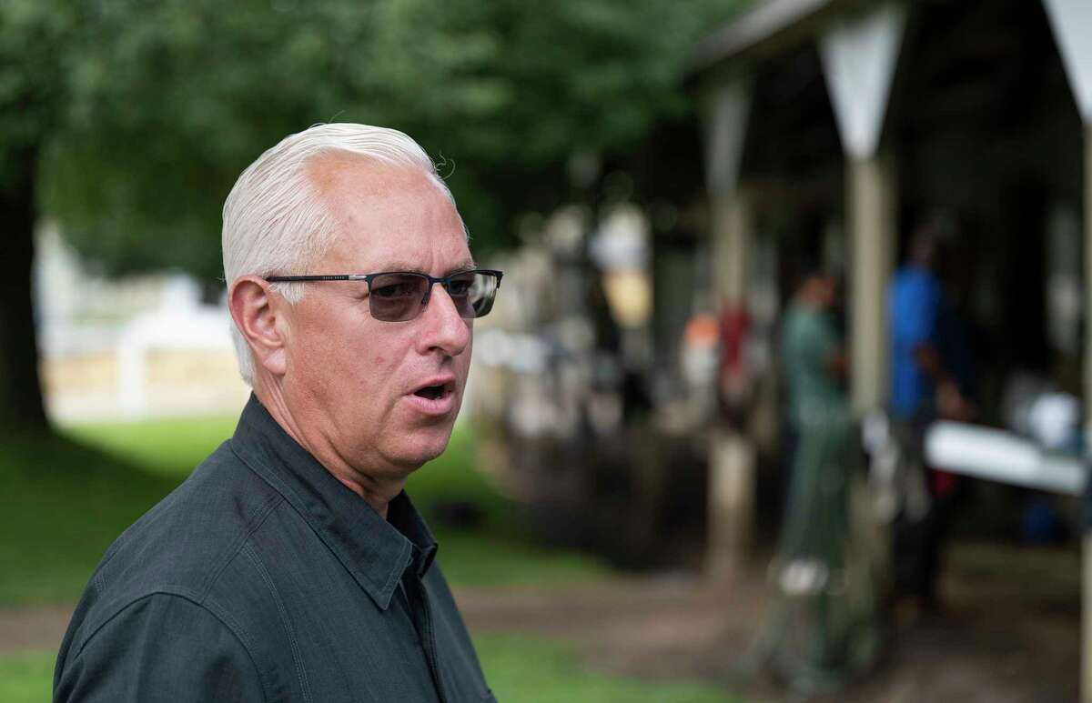 Trainer Todd Pletcher speaks with the Times Union in the barn area of his training barn on the grounds of the Oklahoma Training Center at Saratoga Race Course on Thursday.