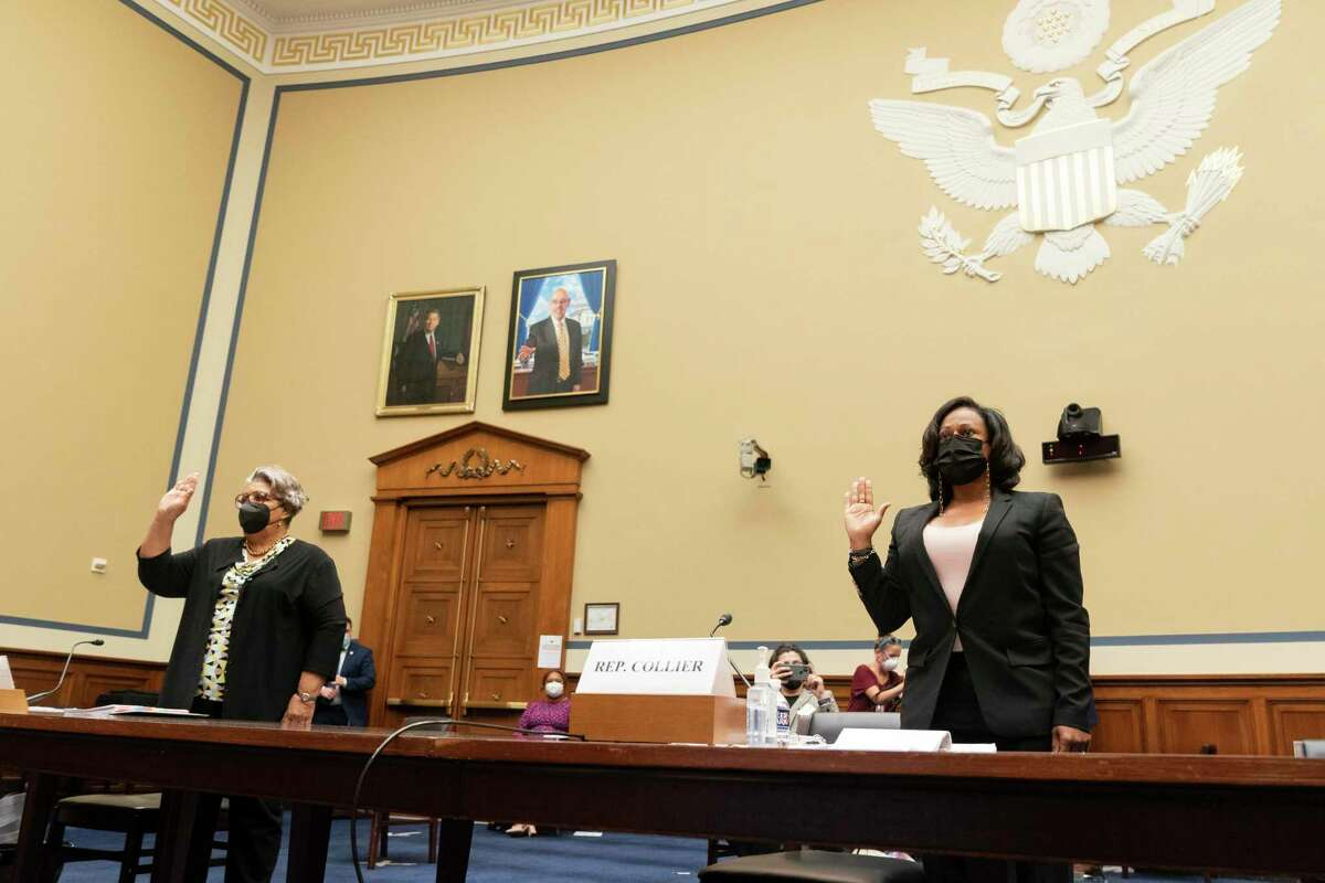 Texas State Democratic Representatives Senfronia Thompson, left, and Nicole Collier Are sworn in during a House Committee on Oversight and Reform hearing about voting rights in Texas, Thursday, July 29, 2021, on Capitol Hill in Washington. (AP Photo/Jacquelyn Martin)