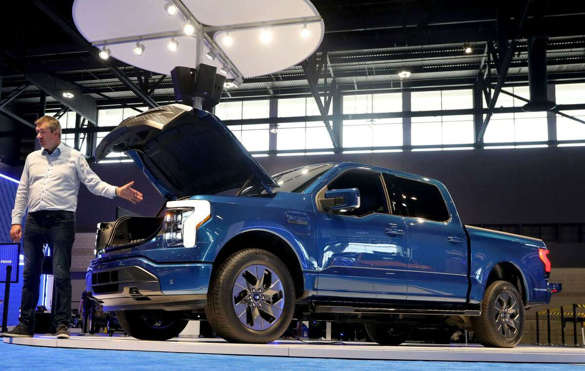 Darren Palmer, head of battery electric vehicles at Ford, describes the unique features of the 2022 Ford F-150 Lightning inside McCormick Place on Wednesday, July 14, 2021. (Antonio Perez/Chicago Tribune/TNS)