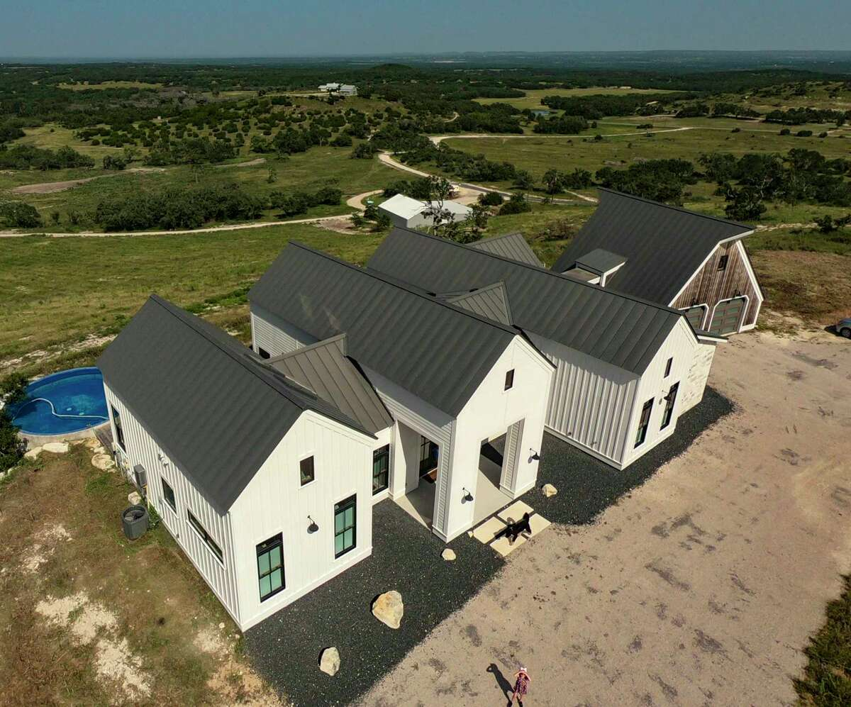 """The 2,800-square-foot home is what Regan Meador describes as """"a riff off the Georgian style"""" with million-dollar views of the surrounding Hill Country."""