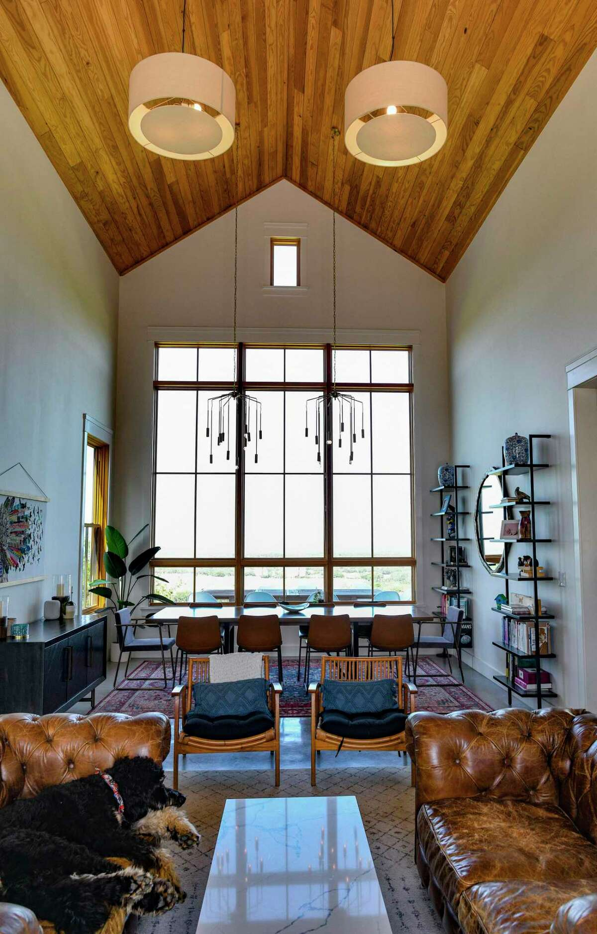 The most dramatic space in the home of Carey and Regan Meador at Southold Farm + Cellar near Fredericksburg is this 40-foot living/dining room with a 23-foot high cathedral ceiling.