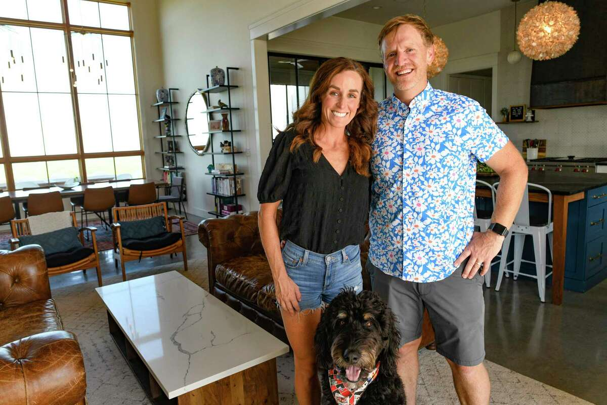 Carey, left, and Regan Meador built their home on their Southold Farm + Cellar vineyard property near Fredericksburg in part because they wanted their children to know what it's like living on a working farm