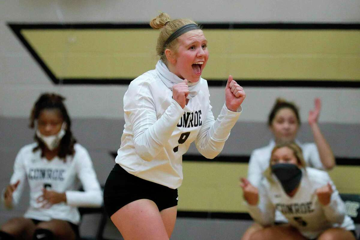 Conroe defensive specialist Emma Malak (9) reacts after a point during the third set of a high school volleyball match at Conroe High School, Tuesday, Oct. 27, 2020, in Conroe.