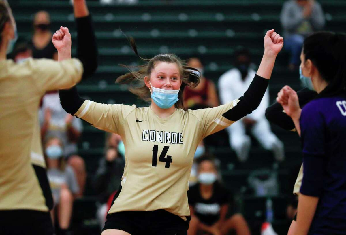 Conroe setter Kenedi Medford (14) reacts after scoring back-to-back aces during the first set of a non-district high school volleyball match at The John Cooper School, Wednesday, Sept. 30, 2020, in The Woodlands