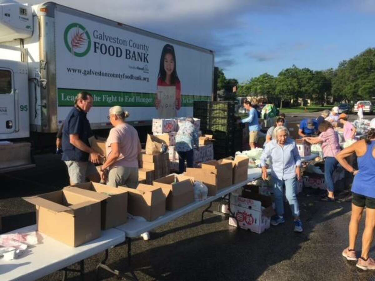 Volunteers distribute fresh fruits, vegetables, meat and hygiene items at a recent food drive coordinated by St. Thomas the Apostle Episcopal Church and the Galveston Food Bank. The next distribution event will be 7:45 a.m. Aug. 7 at 18300 Upper Bay Road. Email Mike Stone, rector@sttaec.org, for details.
