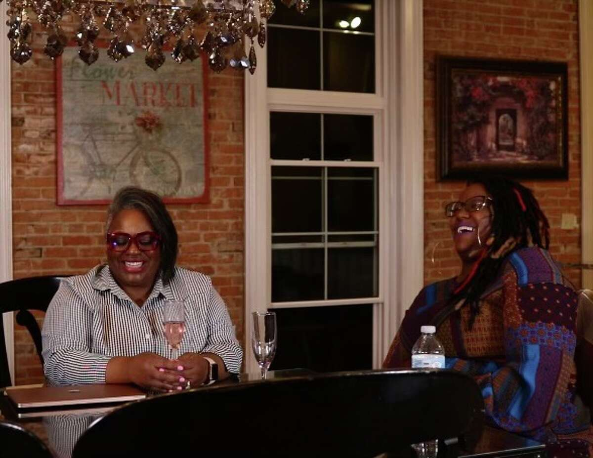 From left, Dawana Grigsby-cox and Erin Patrice at a The Breaking Bread Village discussion.