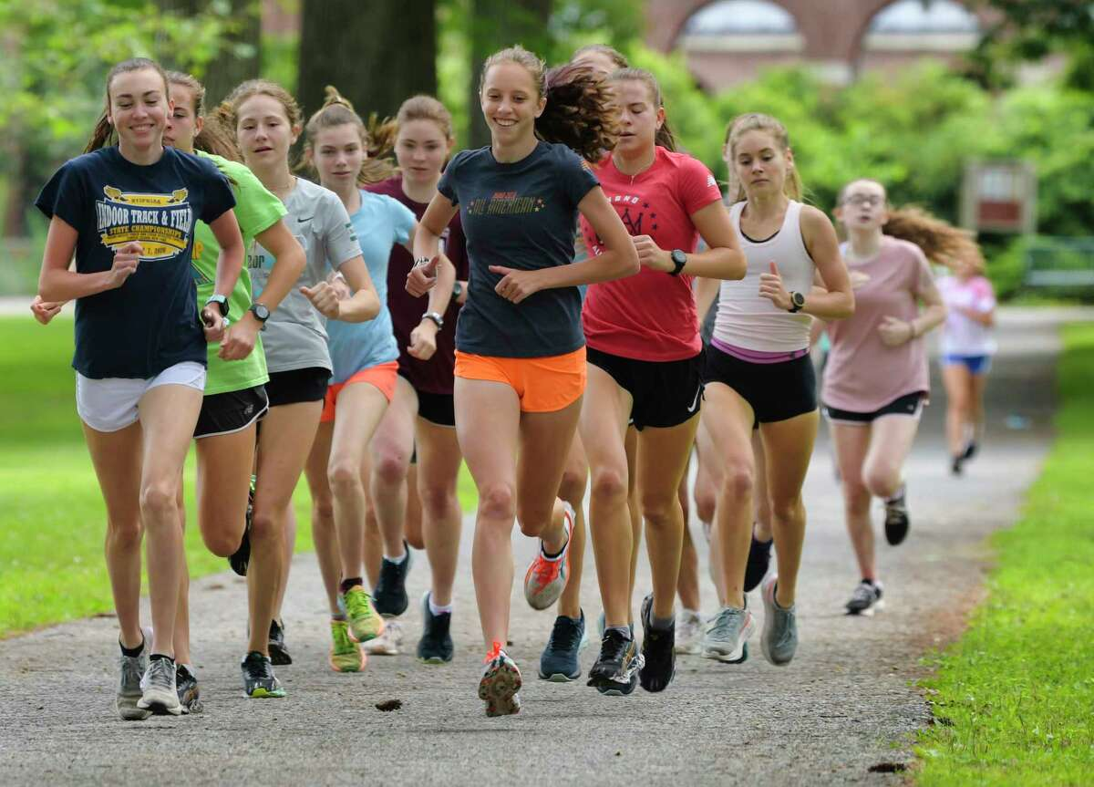 Ella Kurto, front right, works out with other runners in the Saratoga Springs Recreation Department Program on Thursday, July 29, 2021, in Saratoga Springs, N.Y. (Paul Buckowski/Times Union)