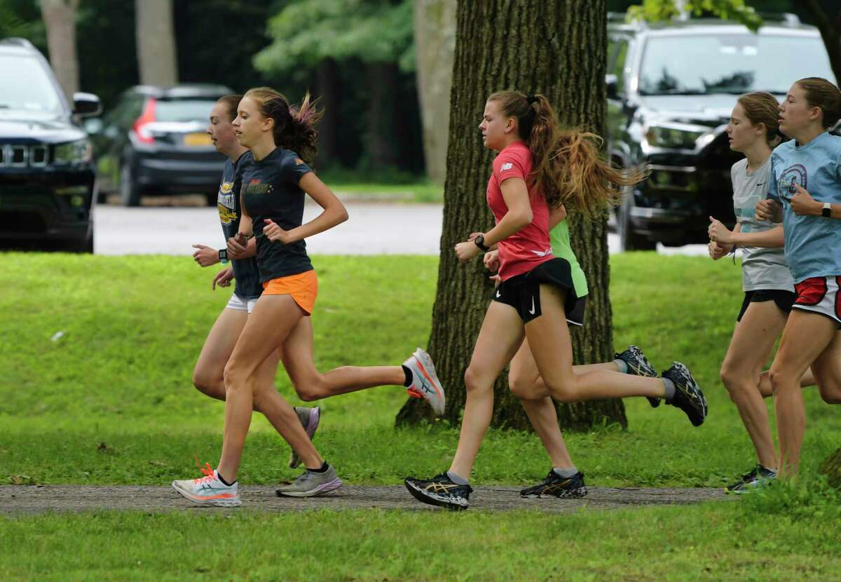 Ella Kurto, left, works out with other runners in the Saratoga Springs Recreation Department Program on Thursday, July 29, 2021, in Saratoga Springs, N.Y. (Paul Buckowski/Times Union)