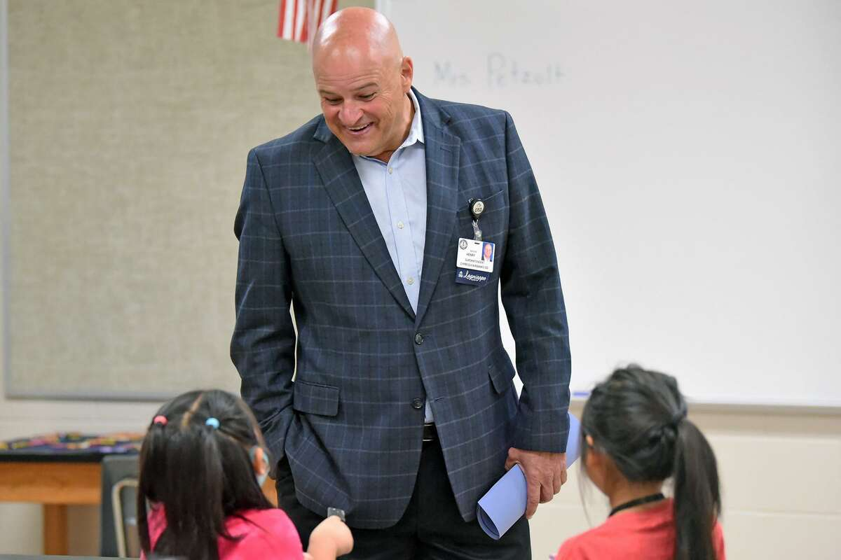 Cy-Fair ISD Superintendent Mark Henry visits with students in school over the summer.
