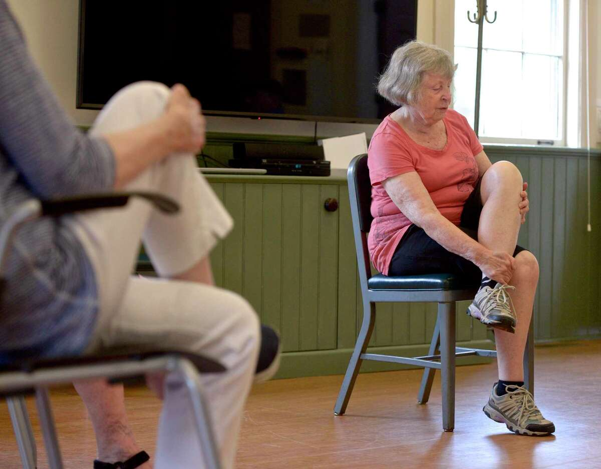 Class leader Janet Wey, of Sherman, instructs the class in a stretch during the morning exercise club at the Sherman Senior Center, Thursday, July 29, 2021, in Sherman, Conn. The town's Commission on Aging is seeking up to $2,500 for a preliminary feasibility analysis of a potential site of a new senior center.
