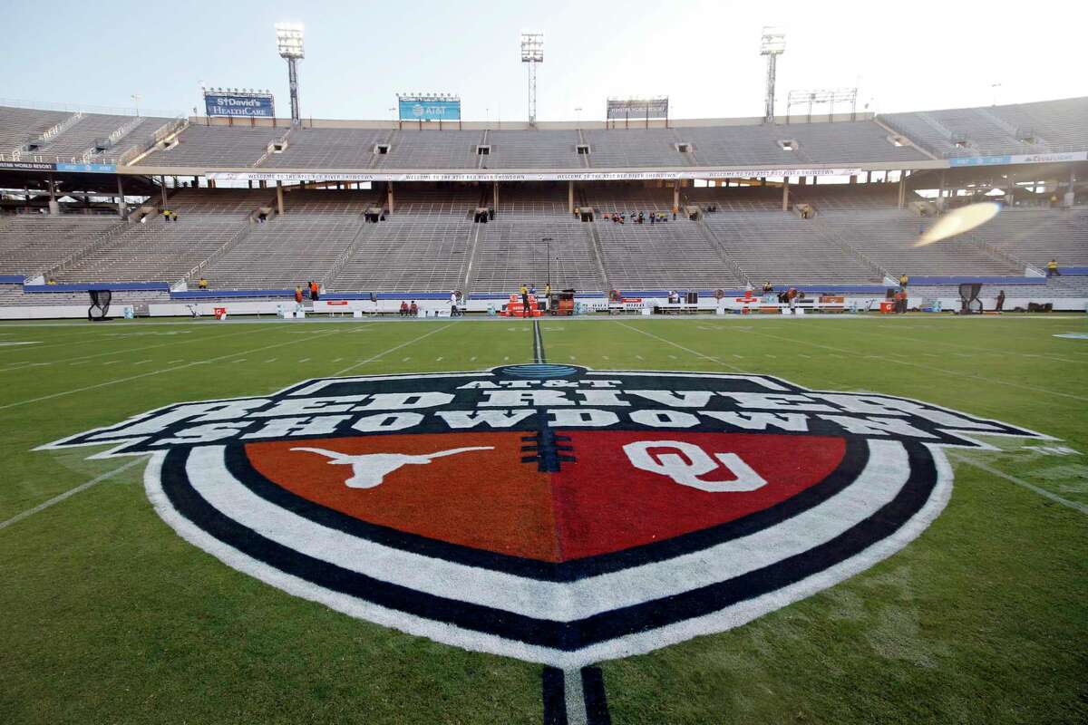 """FILE - In this Oct. 10, 2020, file photo, The Red River Showdown logo is displayed on the field of the Cotton Bowl, prior to an NCAA college football game between the University of Texas and Oklahoma, in Dallas. Texas and Oklahoma made a request Tuesday, July 27, 2021, to join the Southeastern Conference - in 2025 -- with SEC Commissioner Greg Sankey saying the league would consider it in the """"near future."""" (AP Photo/Michael Ainsworth, File)"""