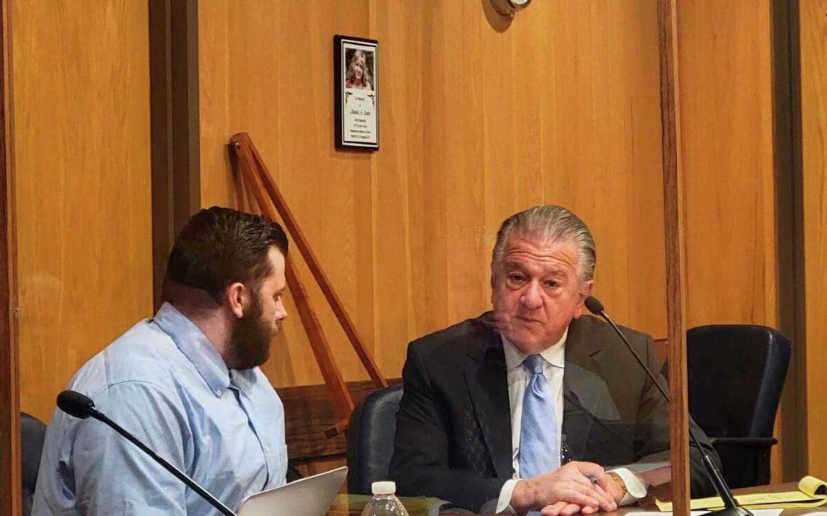 Defendant Taylor Manol and his attorney Craig Elhart discuss Manol taking the stand to testify to the court his experiences the night his neighborAlexander Sarantos was killed during a trial in Benzie County's 19th Circuit Court. (Colin Merry/Record Patriot)