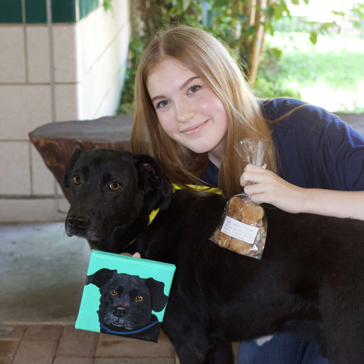 Riley Burwell, a junior counselor at Houston Humane Society's Camp Pawsome, has raised more than $500 to support heartworm-positive pets through sales of her paintings and homemade dog treats.