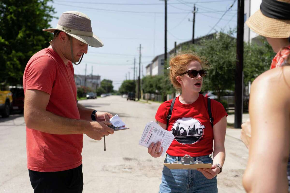 Molly Cook plans with volunteers Ben Peters and Danielle Goshen as they prepare to block walk with the group Stop TxDOT I-45 on July 24, 2021, at an area along Interstate10 just east of downtown Houston near Gregg Street that would be impacted by the Interstate 45 project. The group has been reaching out to neighbors in impacted areas spreading the word about their efforts to stop the current planned expansion of Interstate 45.