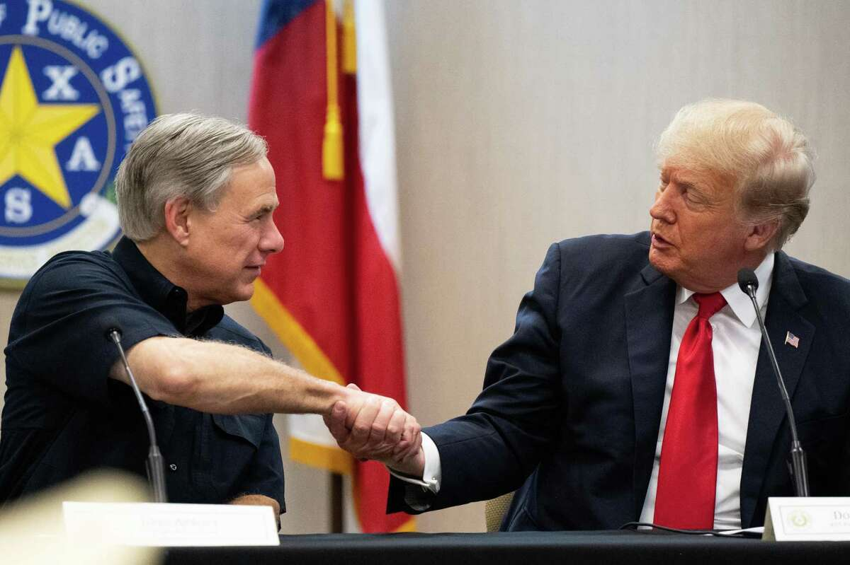 WESLACO, TEXAS - JUNE 30: Texas Gov. Greg Abbott and former President Donald Trump shake hands during a border security briefing on June 30, 2021 in Weslaco, Texas. Gov. Abbott has pledged to build a state-funded border wall between Texas and Mexico as a surge of mostly Central American immigrants crossing into the United States has challenged U.S. immigration agencies. So far in 2021, U.S. Border Patrol agents have apprehended more than 900,000 immigrants crossing into the United States on the southern border. (Photo by Brandon Bell/Getty Images)
