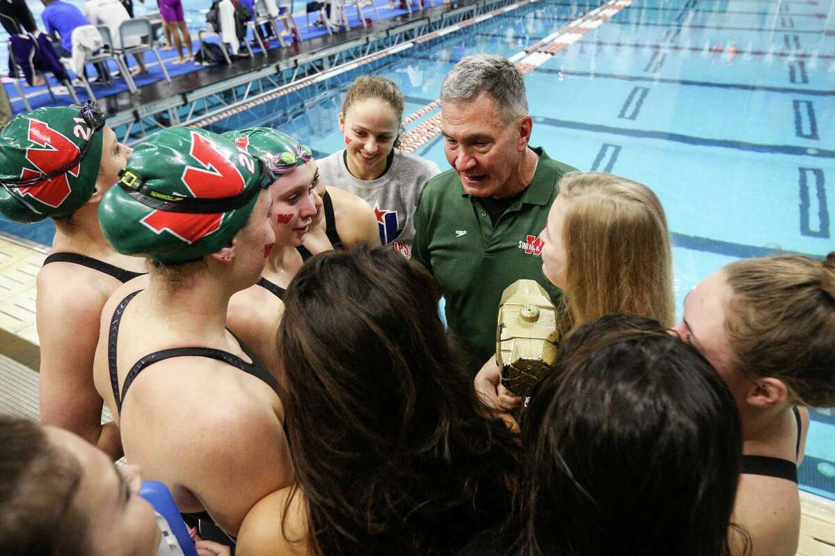 The Woodlands coach Kent Kirchner speaks with the Lady Highlanders after they placed first in the girls 400-yard freestyle relay during the Class 6A UIL Swimming and Diving State Meet on Saturday, Feb. 18, 2017, in Austin.