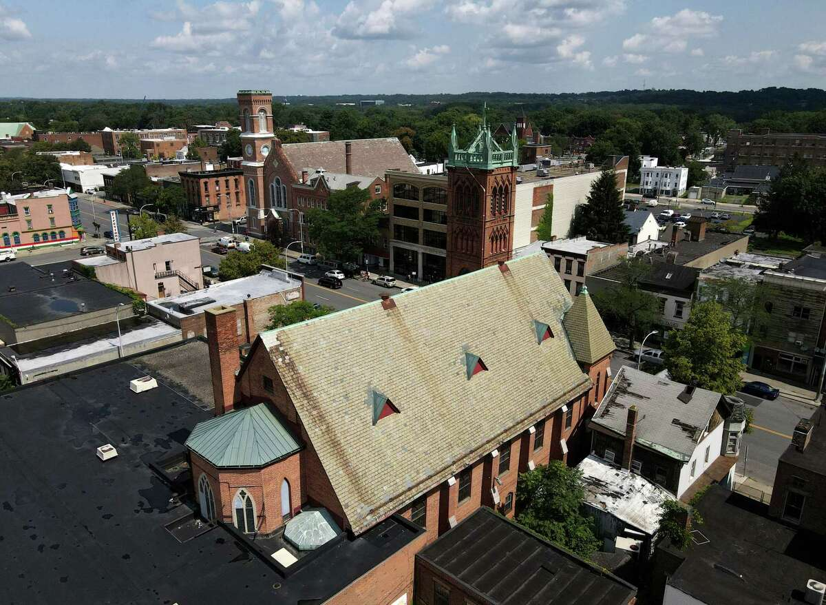 Aerial view of the Capital District Latino's Cultural Empowerment and Community Engagement Center in the former St. John?•s Lutheran Church on Wednesday, July 28, 2021, on Central Avenue in Albany, N.Y. Its slate roof has started to crumble, falling into the courtyard below.