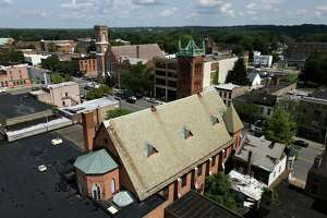 Aerial view of the Capital District Latino's Cultural Empowerment and Community Engagement Center in the former St. JohnÕs Lutheran Church on Wednesday, July 28, 2021, on Central Avenue in Albany, N.Y. Its slate roof has started to crumble, falling into the courtyard below.