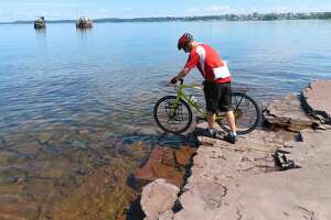 Herb Terns does a ceremonial tire dip in Lake Champlain to begin the trip.