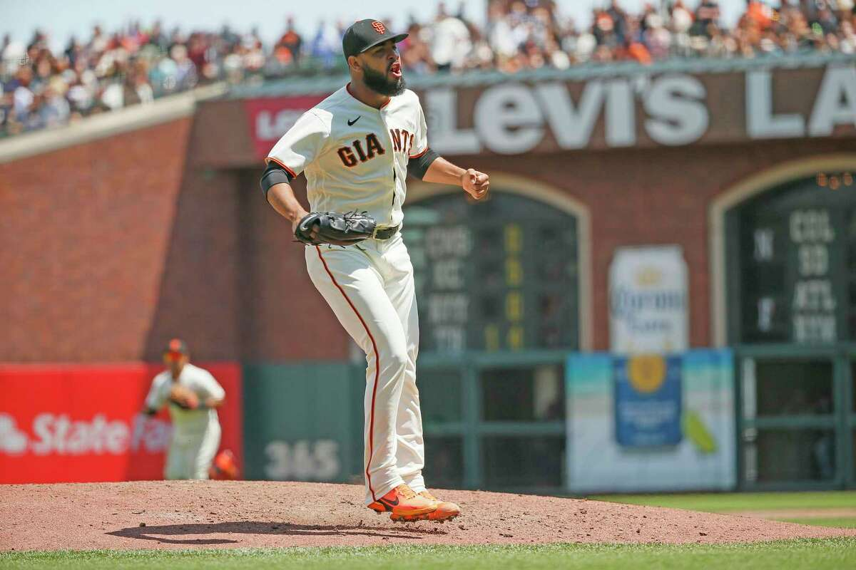 San Francisco Giants relief pitcher Jarlin Garcia (66) reacts after striking out Los Angeles Dodgers Cody Bellinger to end the top of the sixth inning with the bases loaded during an MLB game at Oracle Park, Thursday, July 29, 2021, in San Francisco, Calif.