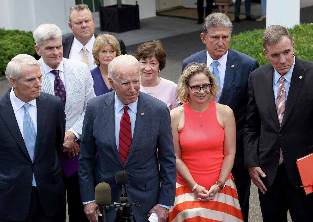 All together now: President Biden with a bipartisan group of senators after a meeting on infrastructure last month.