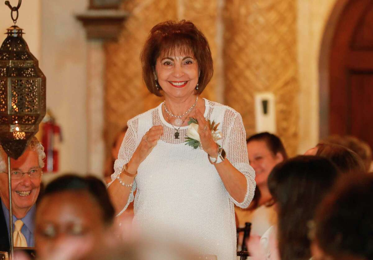 Carol Gooch reacts after being announced as the recipient of the Athena leadership award during a luncheon at Madera Estates, Thursday, July 29, 2021, in Conroe.