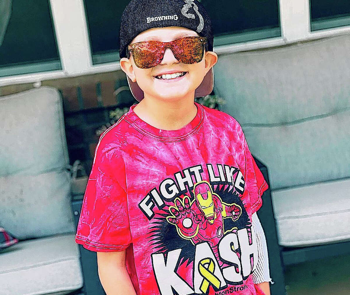 "Kashton Thomas, 9, who is battling cancer, wears a ""Fight Like Kash"" T-shirt that community members help make."