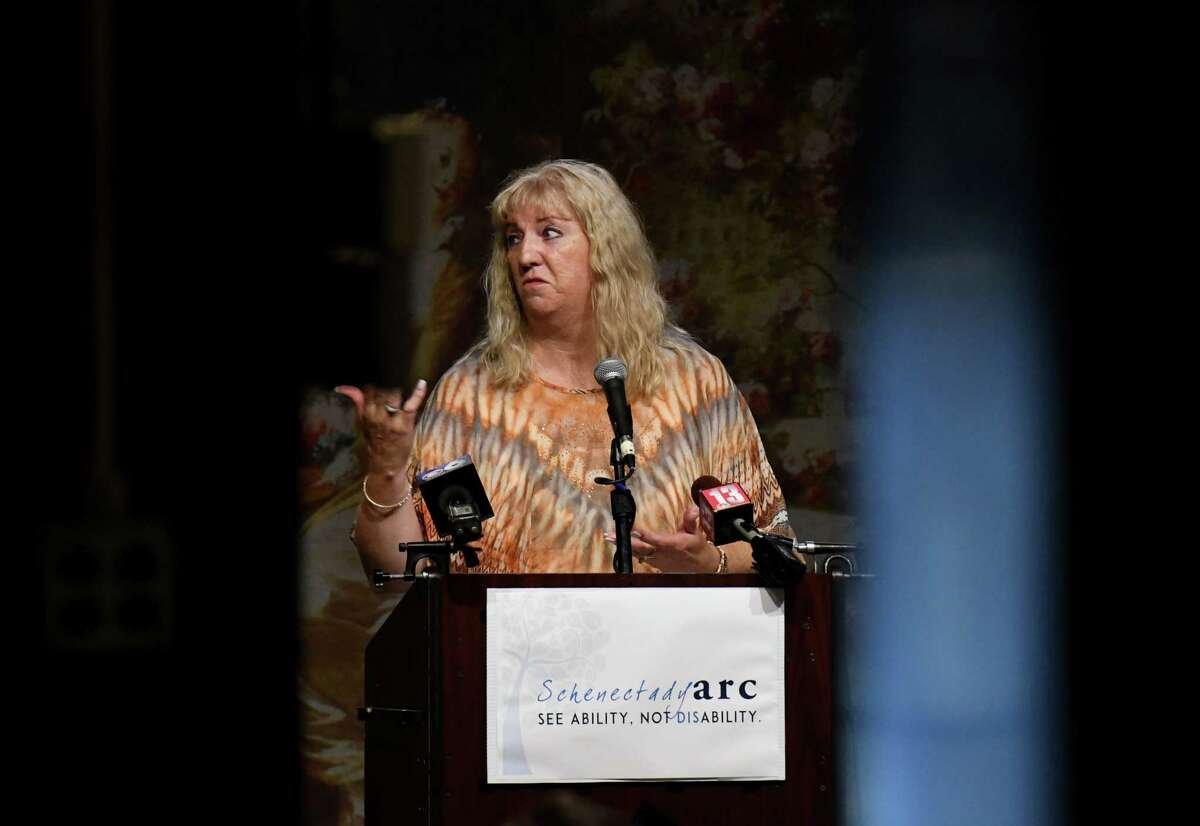 """Cindy Barkowski, who?•s son, John, receives care from direct support professionals, speaks during an advocacy rally for the Schenectady ARC to draw attention to what they contend is a ?""""crisis?• in retaining and recruiting staff on Thursday, July 29, 2021, at Proctors in Schenectady, N.Y."""