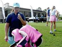 Montana DiLeo of Orange pulls out her game ball during the Women's All Pro Tour golf tournament at the Beaumont Country Club Tuesday. Several local and regional golfers competed in the event. Photo made Tuesday, July 27, 2021 Kim Brent/The Enterprise