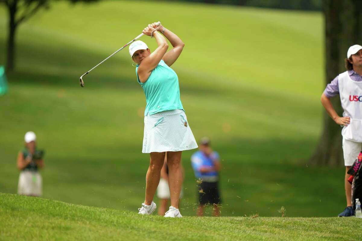 Dana Ebster hits a shot on the ninth hole at the Senior U.S. Women's Open at Brooklawn CC on Thursday.