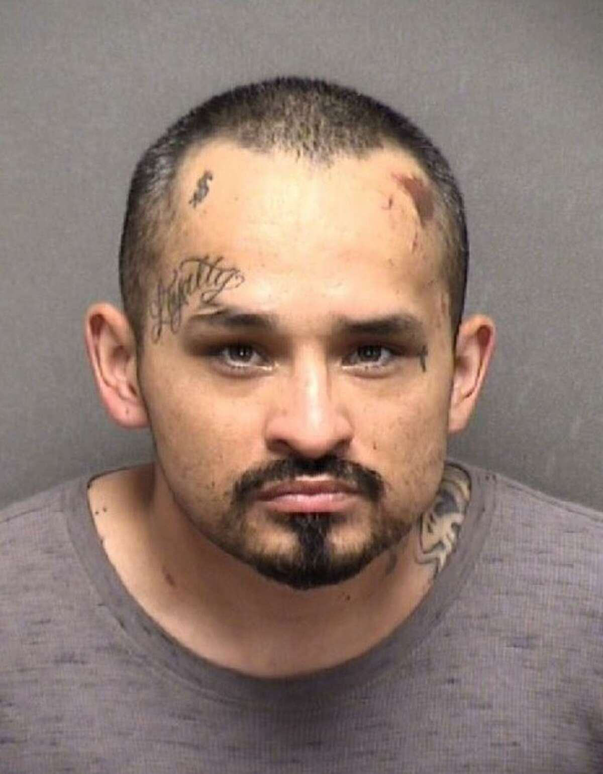 Angel A. Sanchez is accused of pointing a shotgun at San Antonio police during a standoff that lead to his wife's death.