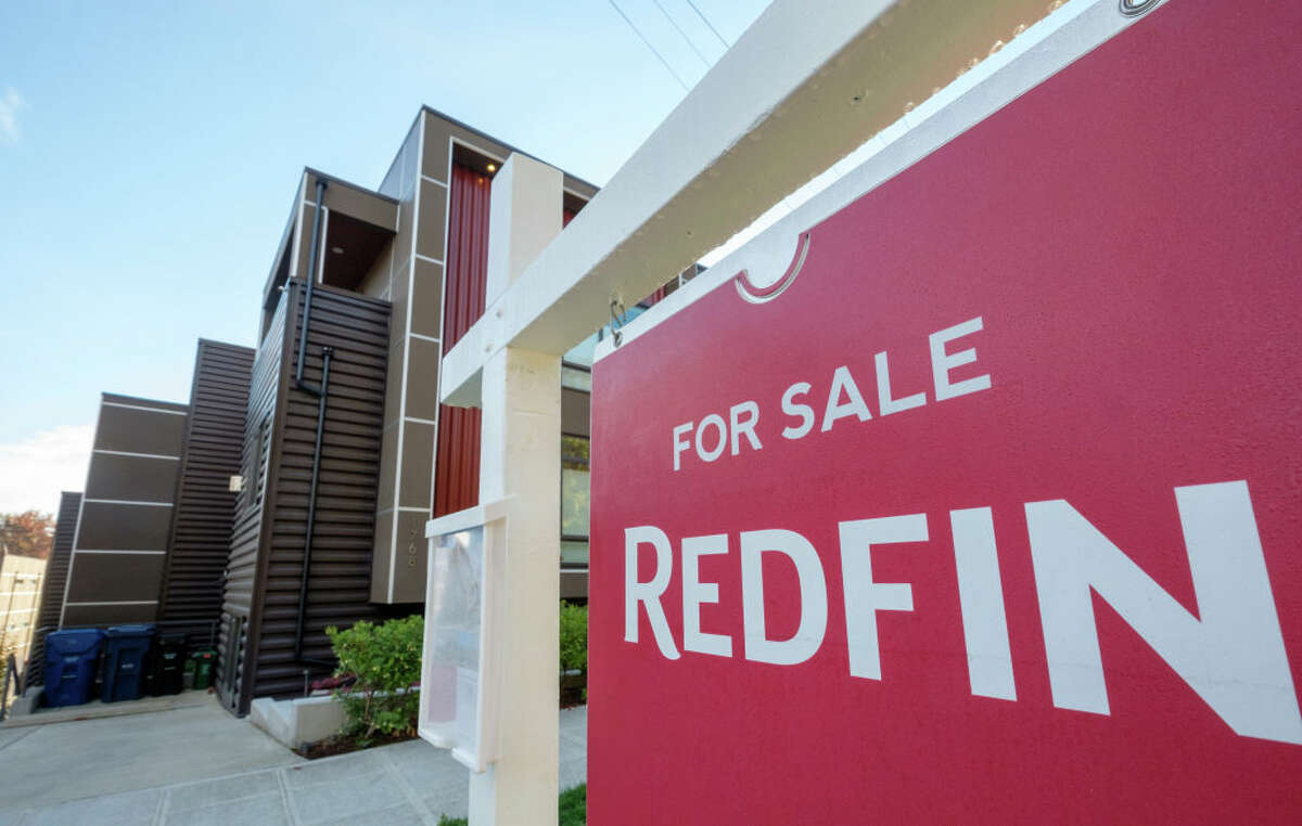A Redfin real estate yard sign is pictured in front of a house for sale on October 31, 2017 in Seattle, Washington.