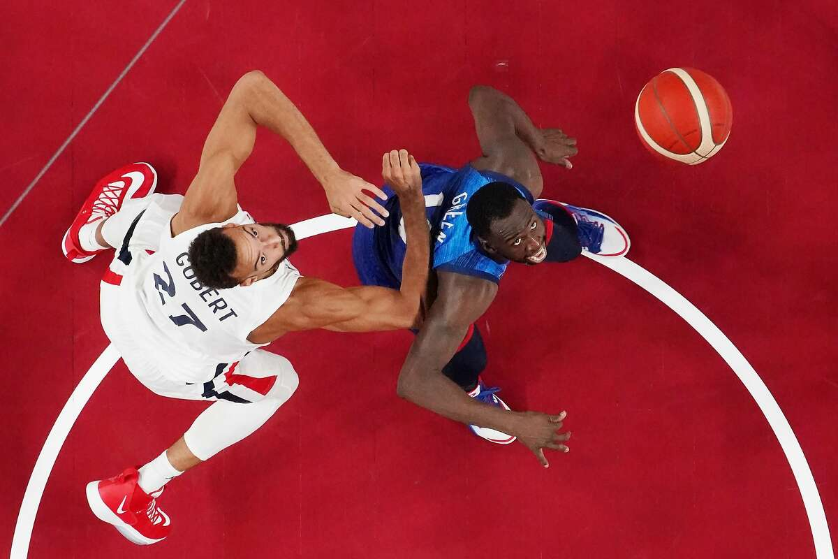 Draymond Green (right, shown against France's Rudy Gobert on Sunday) and the U.S. play the Czech Republic on Saturday.