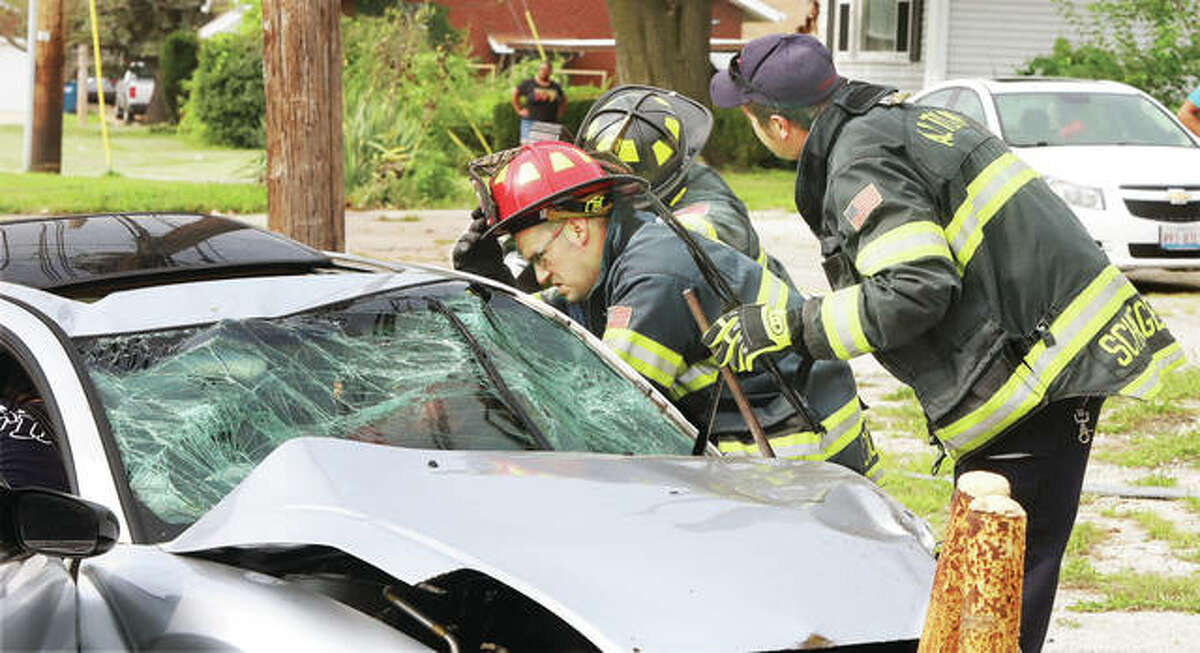 Alton firefighters were called to the scene of an accident about 2:25 p.m. Thursday in the 1100 block of Milton Road. Firefighters had to use a hydraulic rescue tool to open the driver's side door of a silver Mitsubishi Eclipse, which was occupied by a male driver who appeared to be in his 20s.