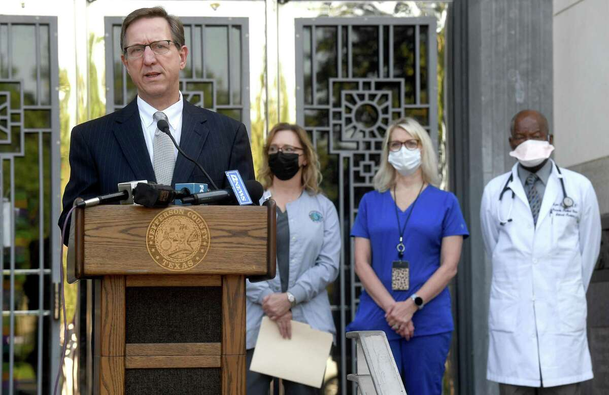 Jefferson County Judge Jeff Branick gathered with county health officials and others to address a spike in COVID-19 cases that is beginning to tax local hospitals. He urged residents to seriously consider getting fully vaccinated. if they have not done so and to wear masks and practice social distancing if they are unvaccinated. Photo made Thursday, July 29, 2021 Kim Brent/The Enterprise