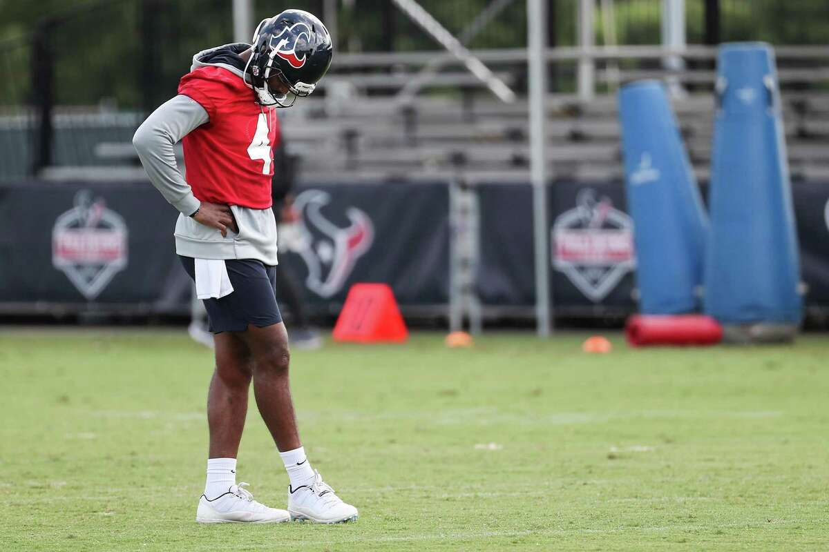 Houston Texans quarterback Deshaun Watson stands on the field during an NFL training camp football practice Thursday, July 29, 2021, in Houston.