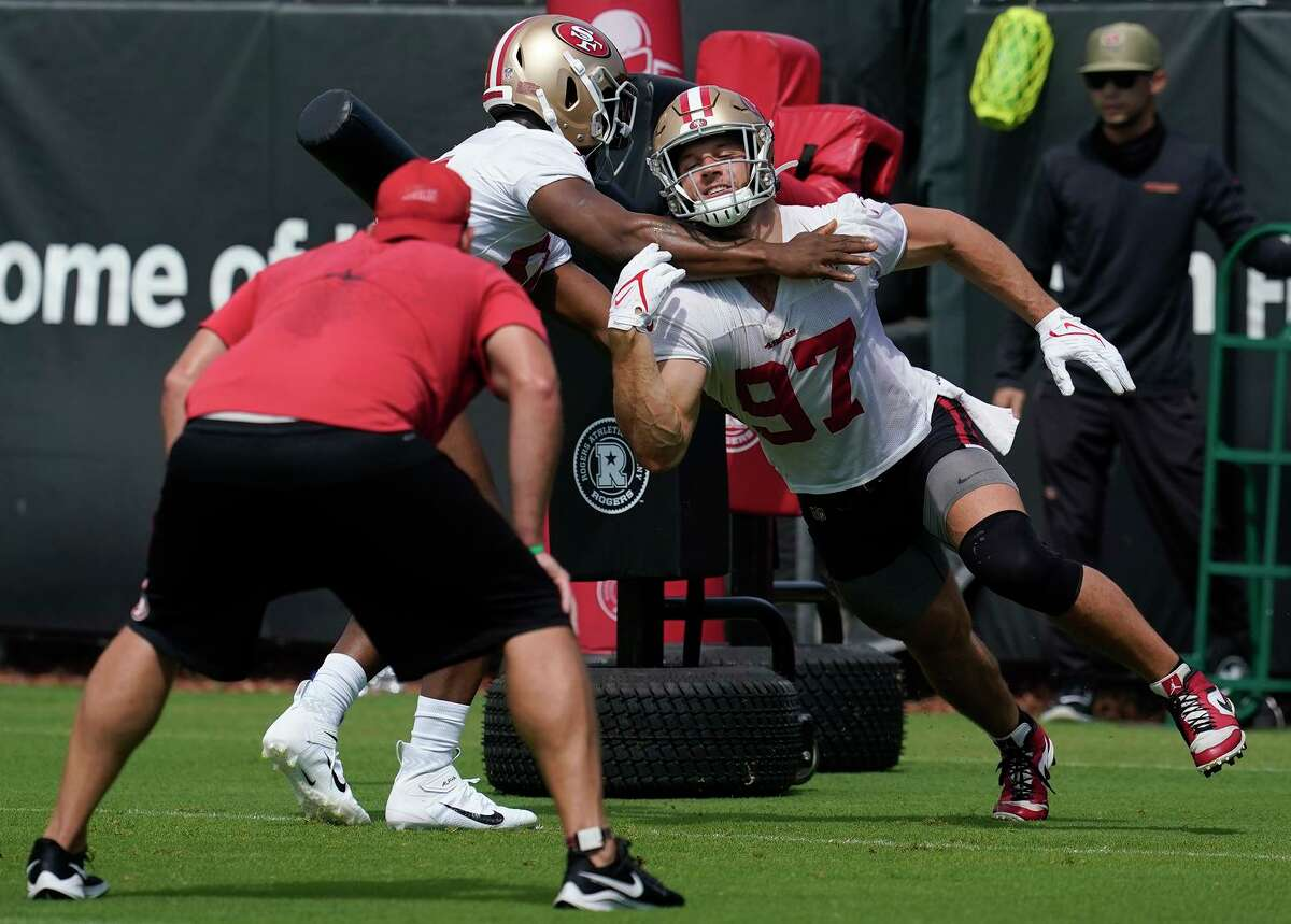 San Francisco 49ers defensive end Nick Bosa (97) works against defensive end Dee Ford at NFL football training camp in Santa Clara, Calif., Thursday, July 29, 2021. (AP Photo/Jeff Chiu)