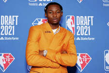 Jonathan Kuminga poses for photos on the red carpet during the 2021 NBA Draft at the Barclays Center on July 29, 2021 in New York City.