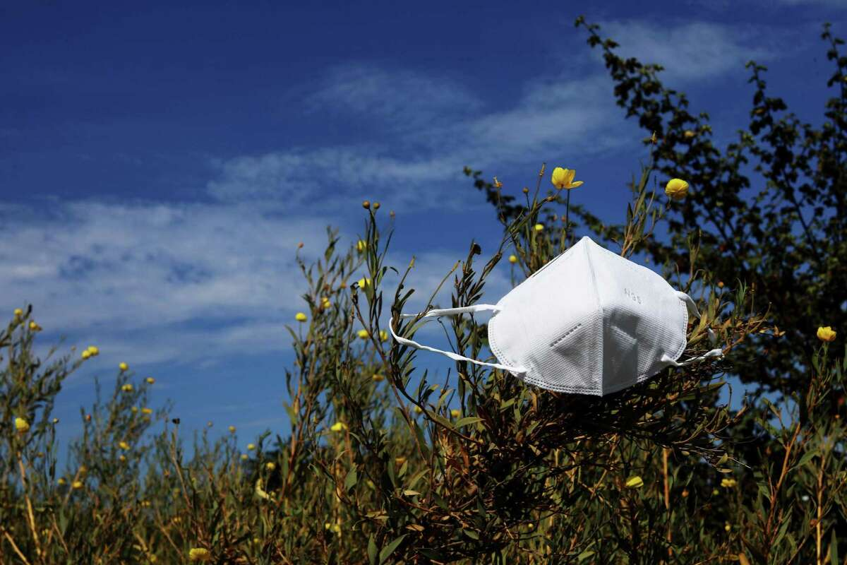 After shedding their masks for a few weeks, vaccinated Bay Area residents are putting them back on as the delta variant spreads.