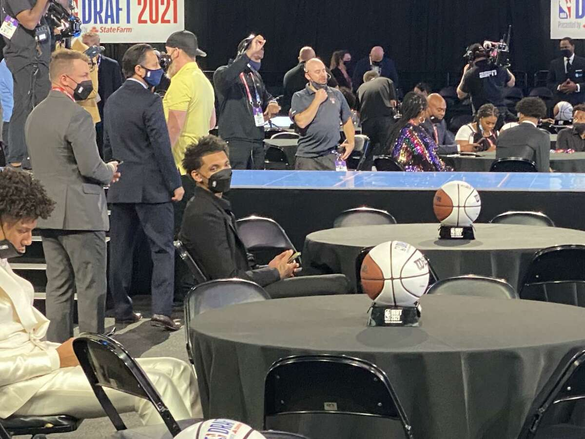 """Former UConn star James Bouknight sitting in the """"Green Room"""" at Thursday's NBA Draft."""