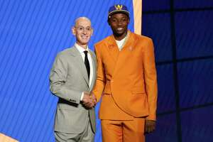 Jonathan Kuminga, right, poses for a photo with NBA Commissioner Adam Silver after being selected seventh overall by the Golden State Warriors during the NBA basketball draft, Thursday, July 29, 2021, in New York.