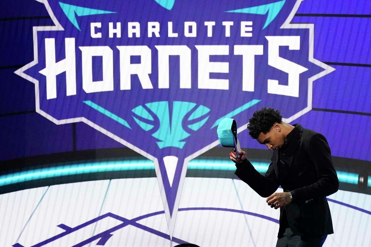 James Bouknight steps off the stage after being selected 11th overall by the Charlotte Hornets during the NBA Draft on Thursday.