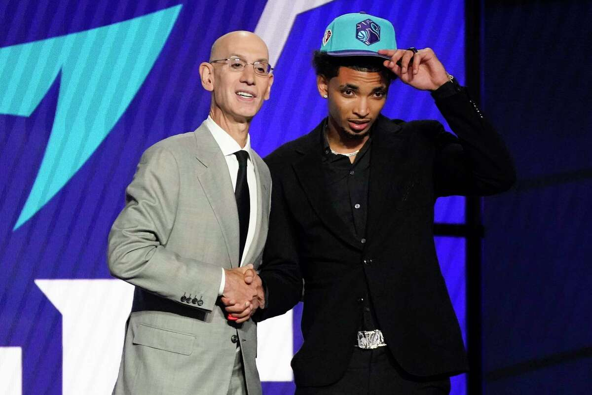 James Bouknight, right, poses for a photo with NBA Commissioner Adam Silver after being selected 11th overall by the Charlotte Hornets in the NBA Draft on Thursday.