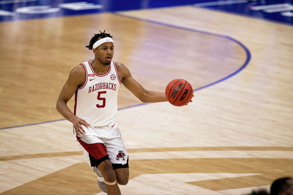 Moses Moody of the Arkansas Razorbacks dribbles at halfcourt against the LSU Tigers during the first half of their semifinal game in the SEC Men's Basketball Tournament on March 13, 2021.