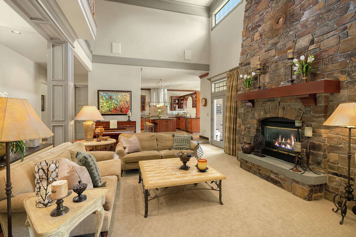 A huge hearth warms the living room.