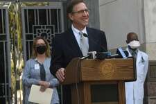 Jefferson County Judge Jeff Branick gathered with county health officials and others to address a spike in COVID-19 cases that is beginning to tax local hospitals. He urged residents to seriously consider getting fully vaccinated if they have not done so and to wear masks and practice social distancing if they are unvaccinated. Photo made Thursday, July 29, 2021 Kim Brent/The Enterprise