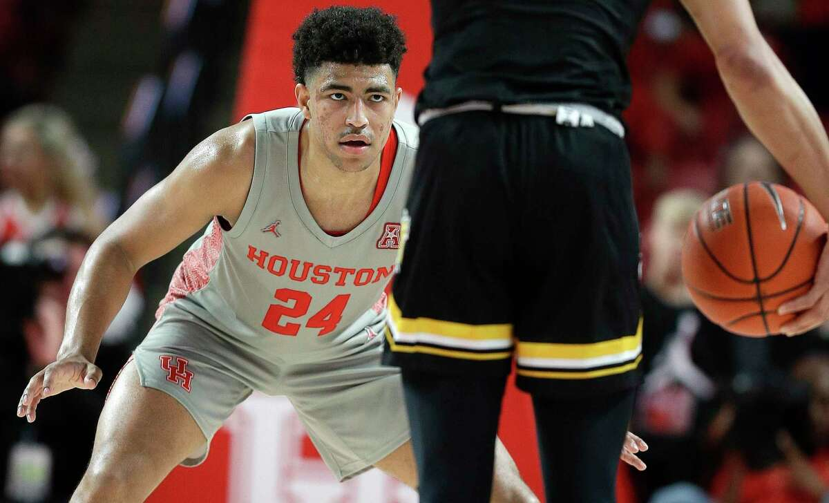 Houston guard Quentin Grimes (24) defends Wichita State guard Dexter Dennis during the first half of an NCAA college basketball game, Sunday, Feb. 9, 2020, in Houston.