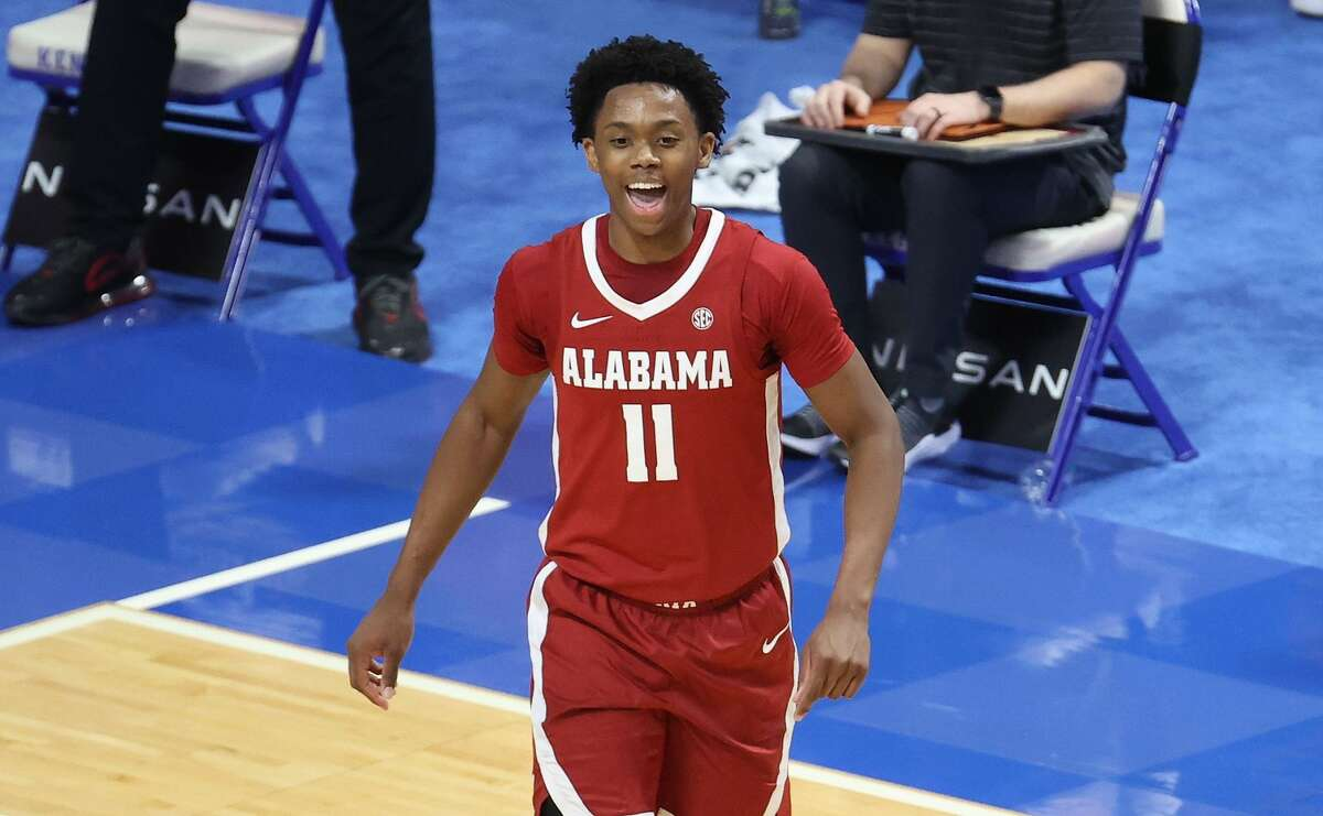 Joshua Primo #11 of the Alabama Crimson Tide celebrates during the 85-65 win over the Kentucky Wildcats at Rupp Arena on January 12, 2021 in Lexington, Kentucky. (Photo by Andy Lyons/Getty Images)