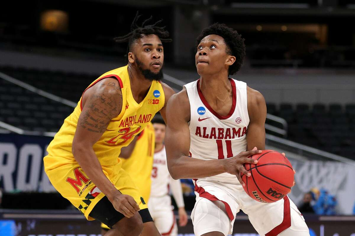 Joshua Primo #11 of the Alabama Crimson Tide handles the ball against Donta Scott #24 of the Maryland Terrapins in the second half in the second round game of the 2021 NCAA Men's Basketball Tournament at Bankers Life Fieldhouse on March 22, 2021 in Indianapolis, Indiana. (Photo by Stacy Revere/Getty Images)